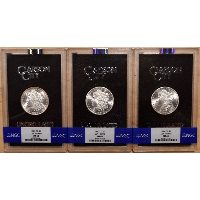 Set of 3 Carson City GSA Morgan Dollars, 1882-CC, 1883-CC, 1884-CC, all NGC MS63