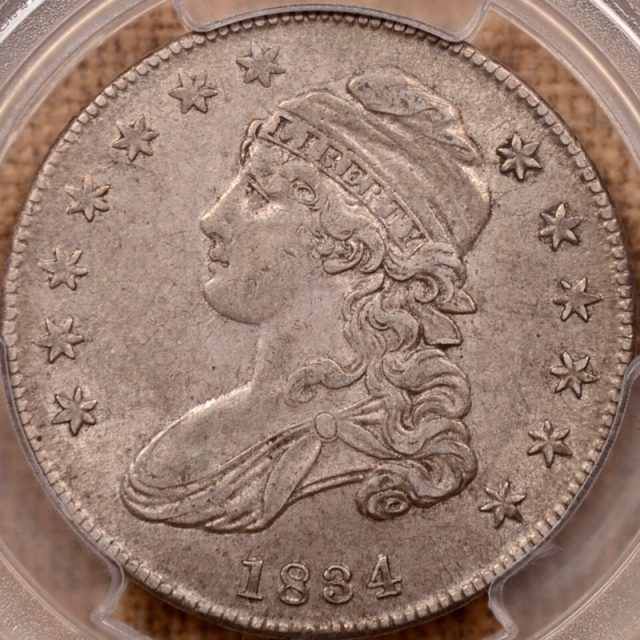 1834 O.115 Small Date, Small Letters Capped Bust Half Dollar PCGS AU50 (CAC)